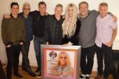 Kesha Presented Platinum Plaque For Praying